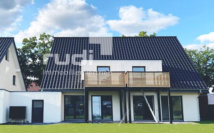 Gartenansicht der Erdgeschosswohnung und Maisonette-Wohnung in Lippstadt / Lipperbruch
